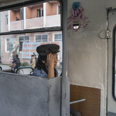 DPR Korea Chongjin A trolley-bus attendant; Chongjin, North Hamgyong Province. While the number of automobiles, including taxis, has increased in recent years, city dwellers make extensive use of public transportation.  © Carl De Keyzer - Magnum