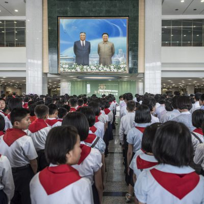 Pyongyang, DPR Korea Students pay their respects to a portrait of President Kim Il Sung and General Kim Jong Il; Science and Technology Complex.  © Carl De Keyzer - Magnum